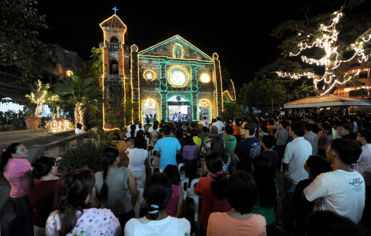 People attend the first of nine dawn masses at a Roman Catholic Church in Las Pinas City on the outskirts of Manila on December 16, 2012 to signal the official start of the Christmas season. The tradition of dawn masses, which culminates on Christmas Eve, dates back to the Spanish era. It is a popular belief that anyone who attends all nine masses will have his wishes granted. (Jay Directo/AFP/Getty Images)