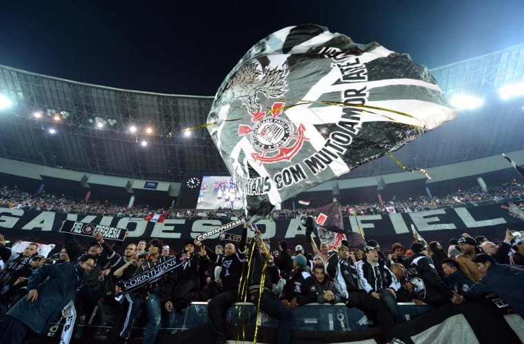 Brazil's Corinthians supporters celebrate their team's victory in the 2012 Club World Cup football tournament in Yokohama on December 16, 2012. Copa Libertadores Champion Corinthians beat UEFA Champion Chelsea FC 1-0. (Toshifumi Kitamura/AFP/Getty Images)