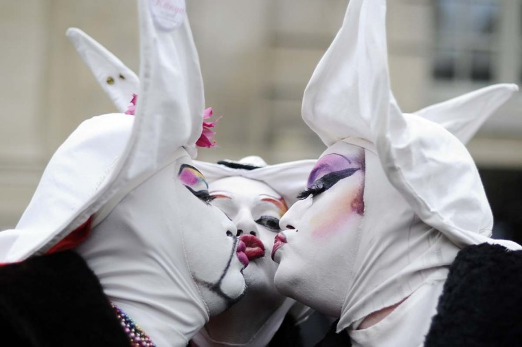 Three men dressed up as nuns kiss each other during a demonstration for the legalization of gay marriage and LGBT parenting, in Paris on December 16, 2012. (Lionel Bonaventure/AFP/Getty Images)