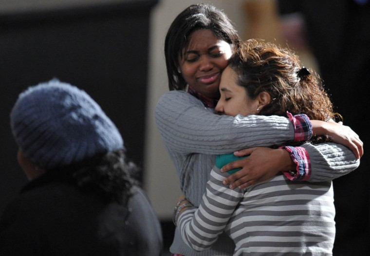 Two young women hug at a memorial service for the victims and relatives of the Sandy Hook Elementary School shooting on December 16, 2012 in Newtown, Connecticut. US President Barack Obama will address the memorial for the twenty-six people, 20 of them children, who were killed when a gunman entered Sandy Hook Elementary and began a shooting spree. (Mandel Ngan/Getty Images)