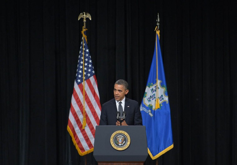 US President Barack Obama speaks at a memorial service for the victims of the Sandy Hook Elementary School shooting on December 16, 2012 in Newtown, Connecticut. Obama will address the memorial for the twenty-six people, 20 of them children, who were killed when a gunman entered Sandy Hook Elementary and began a shooting spree. (Mandel Ngan/Getty Images)