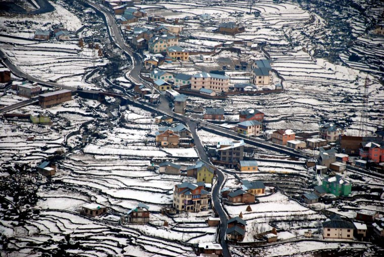 A general view of snow covered fields and villages in the Bhaderwah Valley, some 200 kms east of Jammu on December 16, 2012. According to reports from The Press Trust of India (PTI) residents of Himalayan states are experiencing the first snowfall of the winter season. (STR/AFP/Getty Images)
