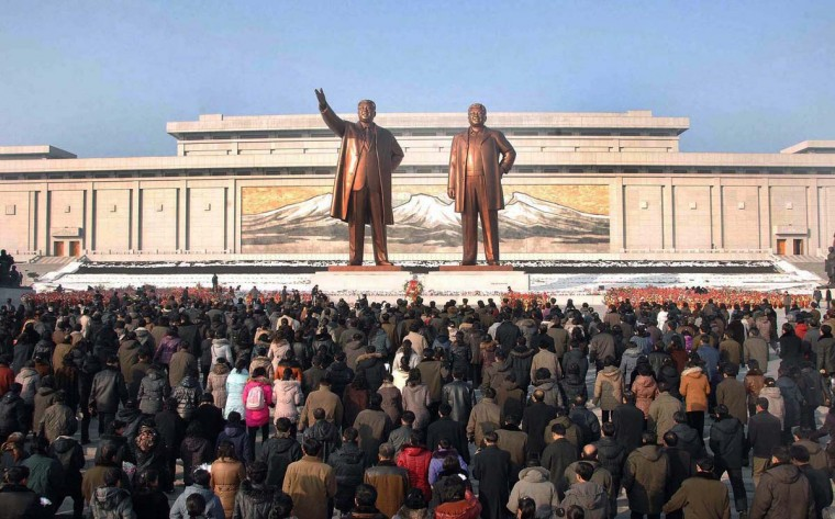 North Korea on December 17 mourned the death one year ago of leader Kim Jong-Il, with its rocket scientists taking pride of place at a mass memorial ceremony led by his son and successor Kim Jong-Un. (Korean Central News Agency via AFP/Getty Images)