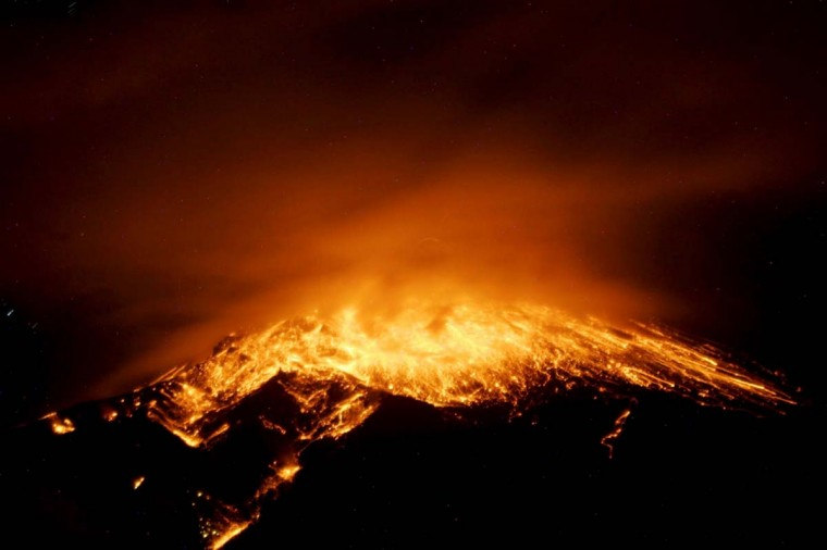 View of an eruption at the Tungurahua volcano, from the city of Banos, early on December 17, 2012. Ecuador issued an orange alert -- the second-highest warning level -- for towns near the Tungurahua volcano on the eve, as its level of activity rose, civil defense officials said. (Agencia API-/AFP/Getty Images)