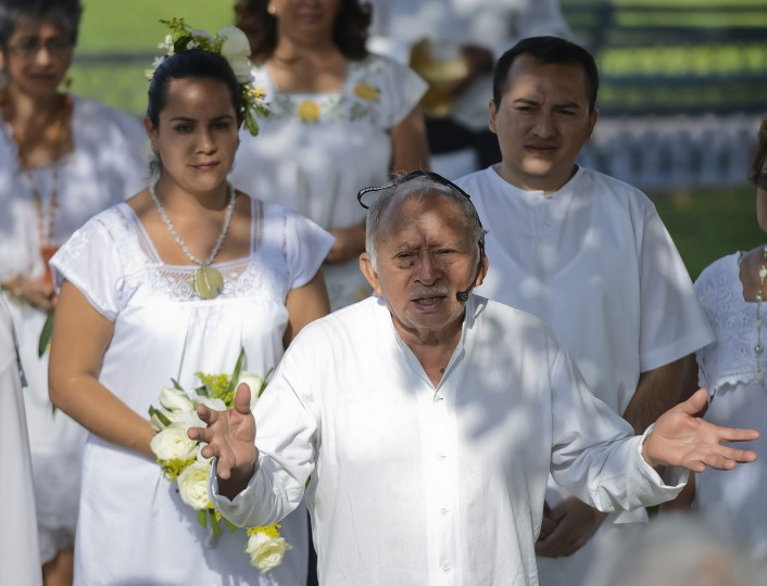 Maya priest Idelfonso Ake Coccom, of the Council of Elders and Mayan priests, conducts the wedding ceremony of Luz Carmen Gonzalez, left, and Jesus Chacon during the last Maya wedding before the end of the 13th baktun cycle and the Long Count Calendar. The 13th baktun is slated to end on Dec. 21, 2012, leading some to predict the end of the world. (Luis Perez/AFP/Getty Images)