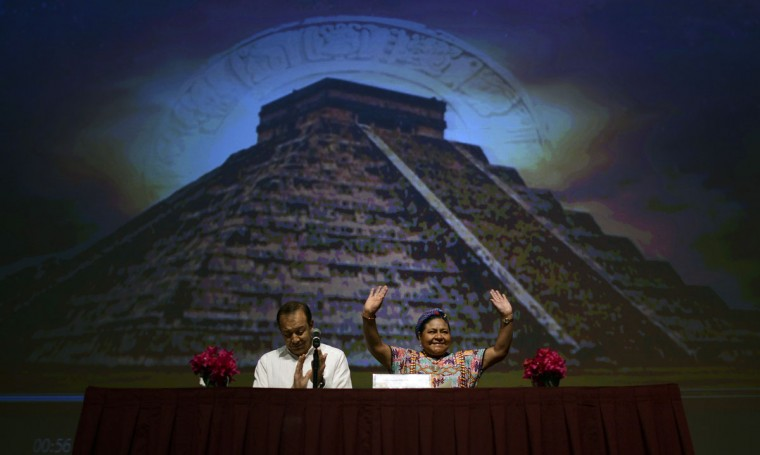 Nobel Peace laureate Rigoberta Menchu, right, and Inocencio Higuera, the director of the Yucatan Investigation Center, take part in a conference in Merida, Mexico, on the life of the current Mayas. The conference was held in part to discuss the relationship current Mayans have with the Maya Long Count Calendar, which says a new era will begin on Dec. 21, 2012. (Luis Perez/AFP/Getty Images)