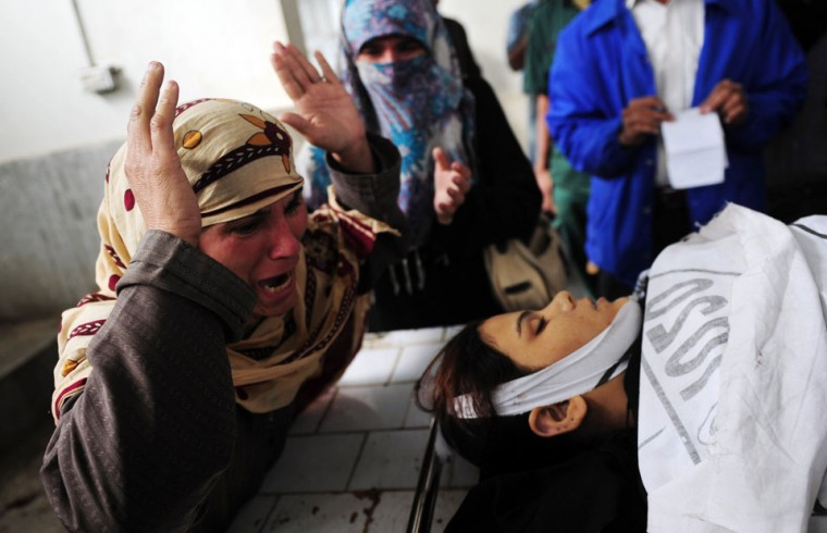 A Pakistani mother mourns beside the body of her daughter, who was killed while on the job as a polio vaccination worker, at a hospital following an attack by gunmen in Karachi. Gunmen on motorbikes shot dead five female Pakistani polio vaccination workers on Tuesday, police said, highlighting resistance to the country's immunisation campaign. Four were killed in three different incidents in the sprawling port city and the fifth in the northwestern city of Peshawar, on the second day of a nationwide three-day drive against the disease, which is endemic in Pakistan. (Rizwan Tabassum/AFP/Getty Images)
