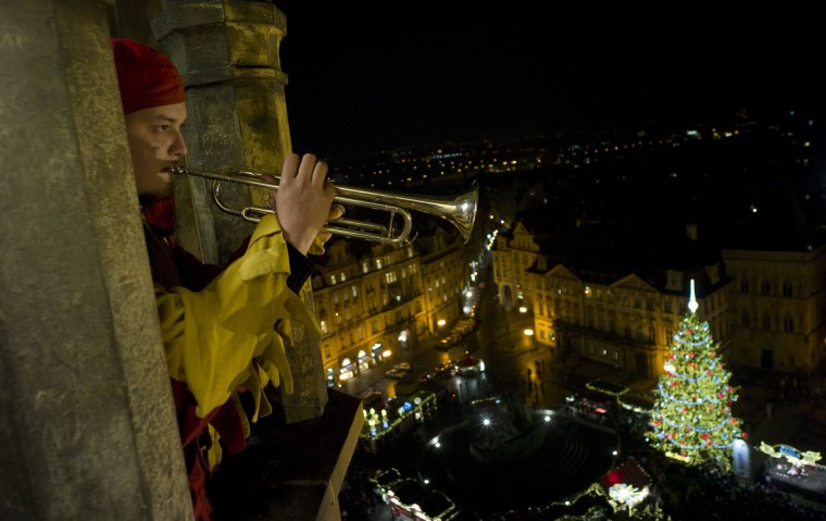 A trumpeter plays from the Old Town tower in front of the traditional Christmas tree placed at the traditional Christmas market on December 17, 2012 at the Old Town Square in Prague. (Michal Cizek/AFP/Getty Images)