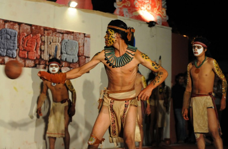 Hondura's Ch'orti Maya and Guatemala's Quirigua vie for the ball in Copan Ruinas, some 400 kilometers west of the Honduran capital of Teguicigalpas. The recreation of an ancient Mayan ball game is part of celebrations that will finish on December 21, when the current Mayan Long Count Calendar cycle comes to an end and a new era begins. According to historians, the Mayan ball game was a form of ritual, where the loser was sacrificed. (Orlando Sierra/AFP/Getty Images)