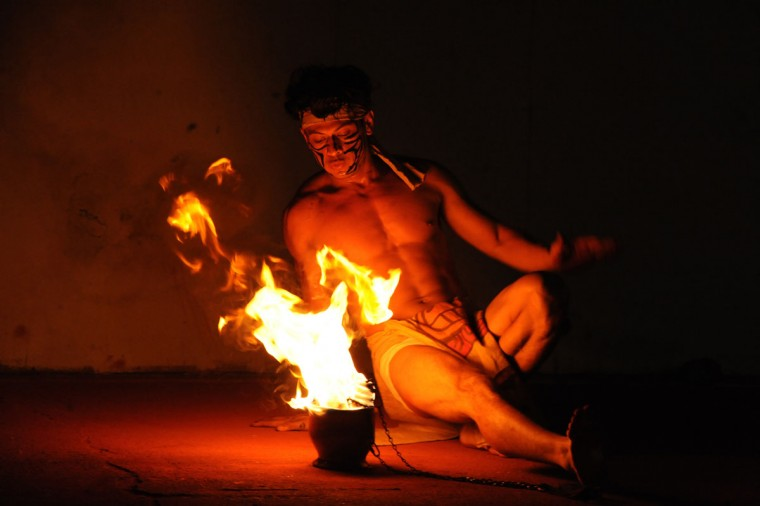 A man performs a fire dance during a recreation of an ancient Mayan ball game between Ch'orti Maya and Guatemala's Quirigua in Copan Ruinas, some 400 kilometers west of the Honduran capital of Teguicigalpas. The recreation of an ancient Mayan ball game is part of celebrations that will finish on December 21, when the current Mayan Long Count Calendar cycle comes to an end and a new era begins. According to historians, the Mayan ball game was a form of ritual, where the loser was sacrificed. (Orlando Sierra/AFP/Getty Images)