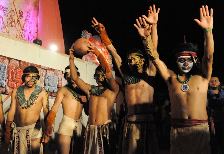 A Ch'orti Maya player celebrates after beating Guatemala's Quirigua, 6-5, in the ancient Mayan ball game held in Copan Ruinas, some 400 kilometers west of the Honduran capital of Tegucigalpa. The game is part of celebrations that will finish on December 21, when the current Mayan Long Count Calendar cycle comes to an end and a new era begins. According to historians, the Mayan ball game was a form of ritual, where the loser was sacrificed. (Orlando Sierra/AFP/Getty Images)