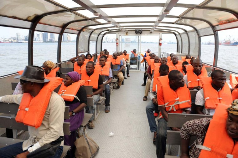 Passengers sit in a ferry at the Marina station in Lagos on November 28, 2012. Over a million Lagosians now uses ferry service yearly as an alternative means of transportation to overcome the chaotic traffic challenges on Lagos roads. (Pius Utomi Expei/AFP/Getty Images)