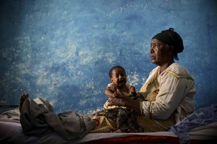 A woman holds a child during a visit by Unicef and WHO program personnel to Merka for an assement of the facilities and to respond to reported cases of cholera and dengue fever. (Tobin Jones/AU-UN IST via AFP/Getty Images)