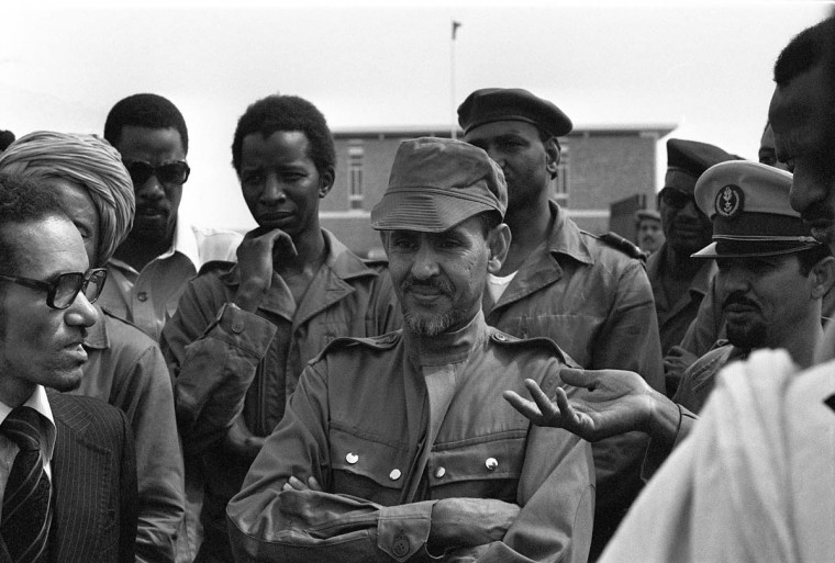 A picture taken on July 31, 1978 shows Mustapha Ould Mohammed Salek (C) surrounded by militaries in Nouakchott, three weeks after he led a military putsch. The former Mauritanian leader died on December 19, 2012, aged 76. (Stringer/AFP/Getty Images)