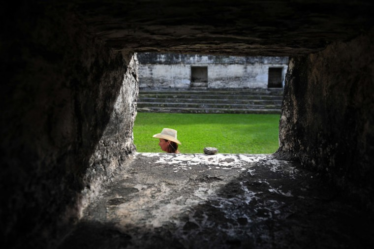 A tourist walks past a Mayan temple at the Tikal archaeological site, located 560 kilometers north of Guatemala City. Ceremonies will be held at the Tikal site to celebrate the end of the Mayan cycle known as Baktun 13 and the beginning of a new Mayan era. (Hector Retamal/AFP/Getty Images)