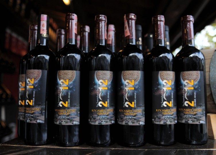 Bottles of wine with labels reading 'the end of the world' are on sale in Sirince, a small village in western Turkey. Believers in doomsday predictions are flocking to Sirinice, which some believe is the only safe haven from the rumored Mayan-predicted apocalypse since the Virgin Mary is said to have risen to heaven from there. (Bulent Kilic/AFP/Getty Images)