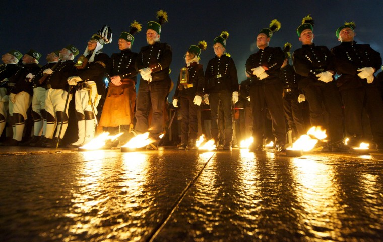 Miners from the Ore Mountains, wearing traditional costumes, take part in the Christmas Miners Parade on December 22, 2012 in Leipzig, eastern Germany. (Peter Endig/AFP/Getty Images)