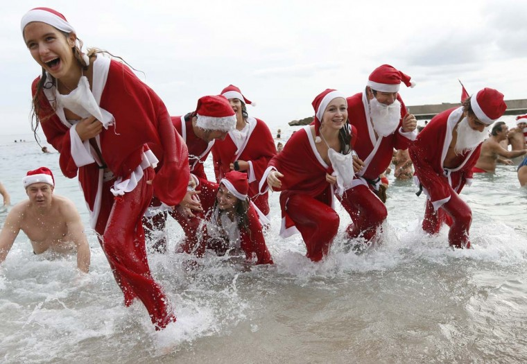 People dressed up as Santa Claus enjoy a traditional Christmas bath on December 23, 2012 in Monaco. (Valery Hachev/AFP/Getty Images)