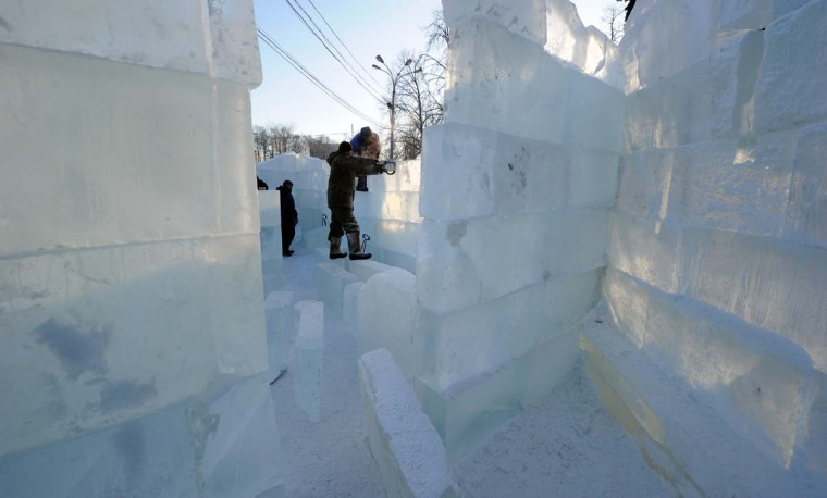 Sculptors build a wall of the ice fortress in a park in central Moscow on December 23, 2012. A cold wave of weather hit this week the Russian capital with temperatures reaching below 20C. (Yuri Kadobnov/AFP/Getty Images)