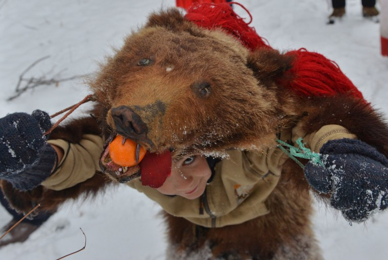 A Romanian child wearing a real bear skin coming from the Bacau region (some 340 km northeast from Bucharest) performs the bears' dance, an ancient tradition before Christmas, in Bucharest, December 23, 2012. Such ceremonies are still popular in the Balkans and Romania, especially during the days between Christmas Eve to Epiphany. Originally, they were ceremonies related to the periodic return of the dead, with people wearing all sorts of masks and behaving like animals such as horses, goats or bears. It is believed that bears banish demons from houses and farmyards and wish inhabitants a happy year. (Daniel Mihailescu/AFP/Getty Images)