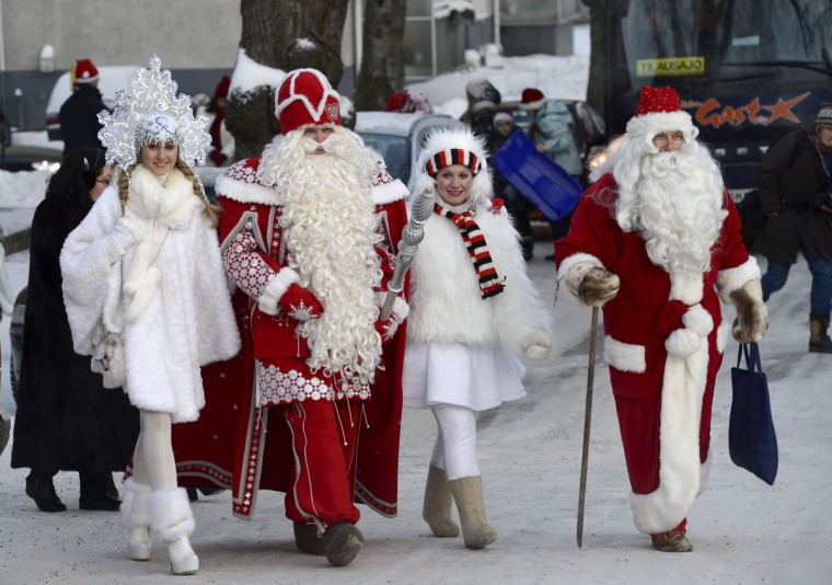 Father Frost (second from left), with his snow maiden, meets with Santa Claus (right) at the Nuijamaa border station between Finland and Russia in Lappeenranta, Finland, on December 23, 2012. (Heikki Saukkomaa/AFP/Getty Images)