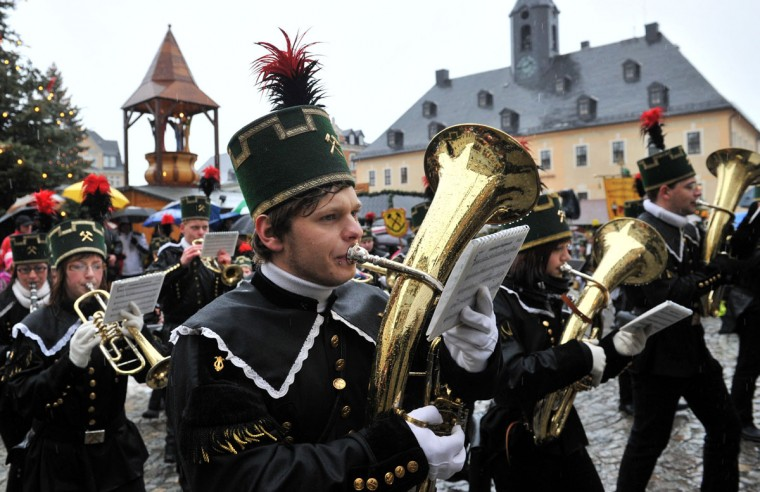 A brass band wearing traditional miner's costumes takes part in a Christmas miners' parade in Annaberg-Buchholz, eastern Germany, on December 23, 2012. The miners' parade is traditionally held in places in Germany where ore was smelted. (Hendrik Schimdt/AFP/Getty Images)