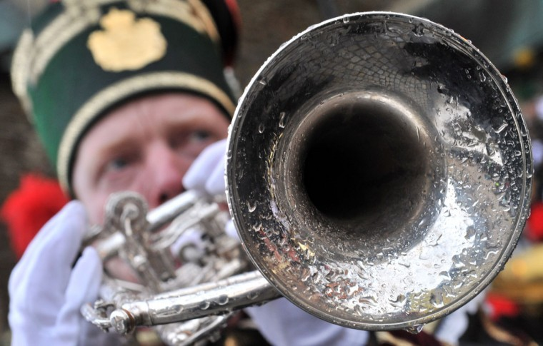 A musician in a brass band wearing a traditional miner's costume takes part in a Christmas miners' parade in Annaberg-Buchholz, eastern Germany, on December 23, 2012. The miners' parade is traditionally held in places in Germany where ore was smelted. (Hendrik Schimdt/AFP/Getty Images)