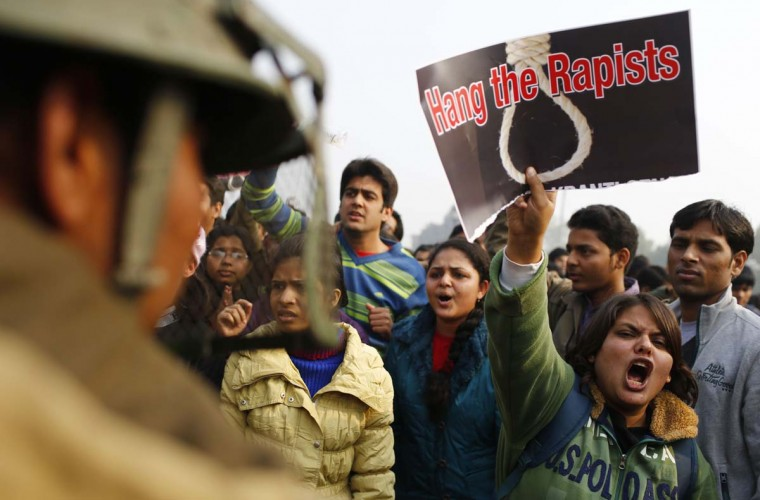 An Indian demonstrator shouts slogans at the police during a protest calling for better safety for women following the rape of a student last week, in front the India Gate monument in New Delhi on December 23, 2012. (Andrew Caballero-Reynolds/AFP/Getty Images)