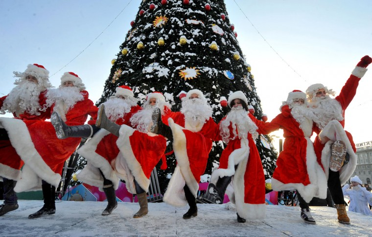 People wearing Father Frost outfits dance during a traditional pre-New Year parade in central Minsk, Belarus on December 23, 2012. (Viktor Drachev/AFP/Getty Images)