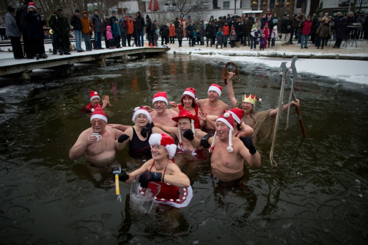 Winter swimmers dressed in Santa Claus costumes enjoy the cold water during a traditional ice swimming session on December 23, 2012 in Lanke, some 50 kilometers north of Berlin. (Johannes Eisele/AFP/Getty Images)