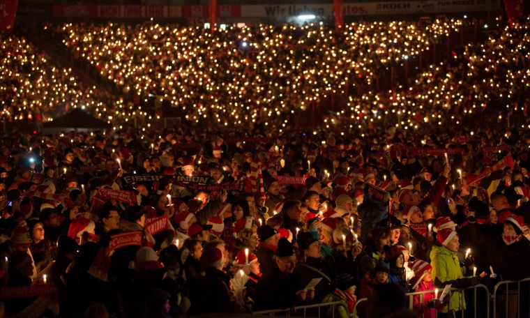 Supporters of the German second-division football club FC Union Berlin attend the 10th Christmas singing at the team's stadium (Stadium Alte Foersterei) in Berlin, on December 23, 2012. For two hours, over 20,000 people sang Christmas songs. (Jörg Carstensen/AFP/Getty Images)