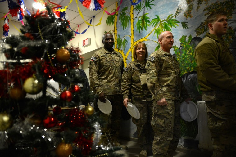 U.S. soldiers line up to take their food during a special meal on Christmas Day at Kabul International Airport on December 25, 2012. There are presently around 100,000 US-led NATO troops fighting a decade-long Taliban led insurgency in Afghanistan. (Shah Marai/AFP/Getty Images)