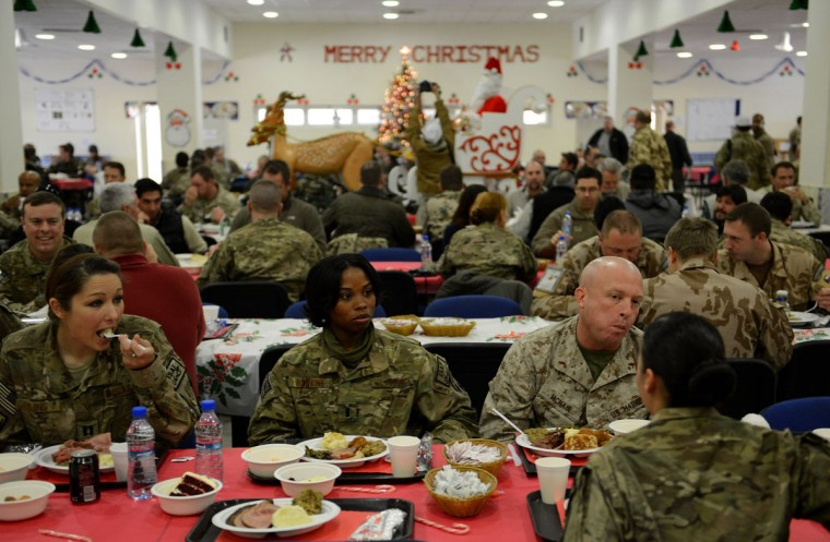 Soldiers with the NATO-led International Security Assistance Force (ISAF) eat their food during a special meal on Christmas Day at Kabul International Airport on December 25, 2012. There are presently around 100,000 US-led NATO troops fighting a decade-long Taliban led insurgency in Afghanistan. (Shah Marai/AFP/Getty Images)