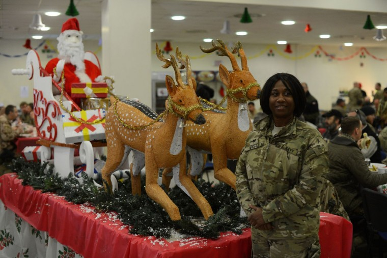 A US soldier poses next to Christmas decorations during a special meal on Christmas Day at Kabul International Airport on December 25, 2012. There are presently around 100,000 US-led NATO troops fighting a decade-long Taliban led insurgency in Afghanistan. (Shah Marai/AFP/Getty Images)