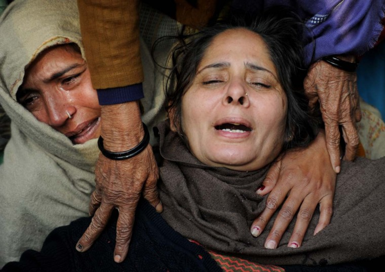 Relatives of Indian policeman Subash Tomar mourn during his funeral in New Delhi on December 25, 2012. Tomar, a 47-year-old constable deployed at the India Gate monument on December 23 to control the protests calling for stricter rape laws, was beaten up by a mob and rushed to a hospital by the police. (Sajjad Hussain/AFP/Getty Images)