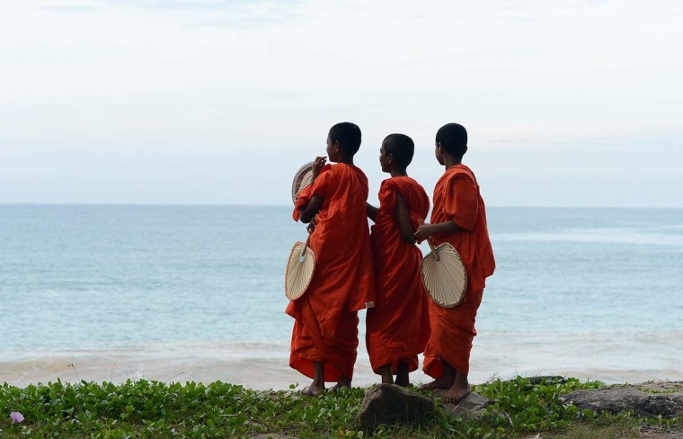 Young Sri Lankan Buddhist monks look on from the beach at Peraliya village in southern Sri Lanka on December 26, 2012, on the eighth anniversary of the Asian tsunami. Some 31,000 people on the island died during the 2004 Asian tsunami and one million were initially left homeless. (Lakruwan Wanniarachchi/AFP/Getty Images)=