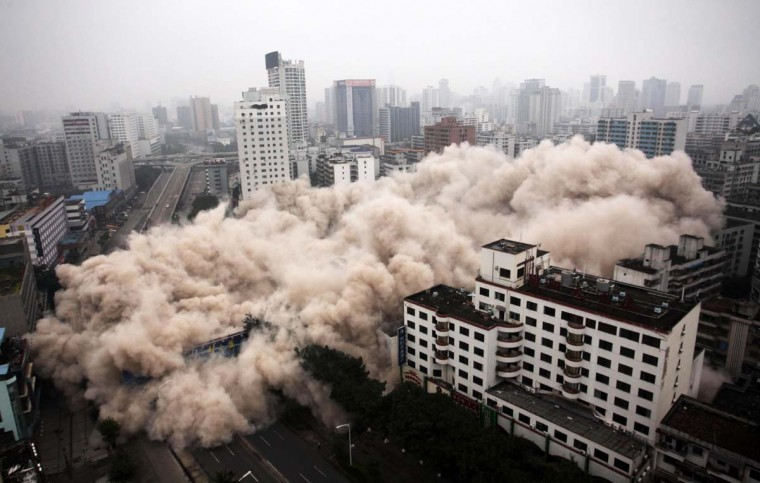 This picture taken on December 25, 2012 shows a building being demolished in Haikou, south China's Hainan province. For the past two years, China has sought to control residential property prices with measures including restrictions on second and third home purchases, higher minimum downpayments, and annual taxes in some cities on multiple and non-locally-owned homes. (STR/AFP/Getty Images)