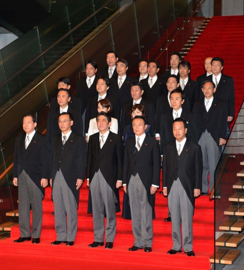 Japan's new Prime Minister Shinzo Abe (front, C) and his cabinet members pose for photo session after their first cabinet meeting at the prime minister's official residence in Tokyo on December 26, 2012. Abe was elected Japan's prime minister by the lower house of parliament after he swept to power on a hawkish platform of getting tough on diplomatic issues while fixing the economy. (Kazuhiro Nogi/AFP/Getty Images)