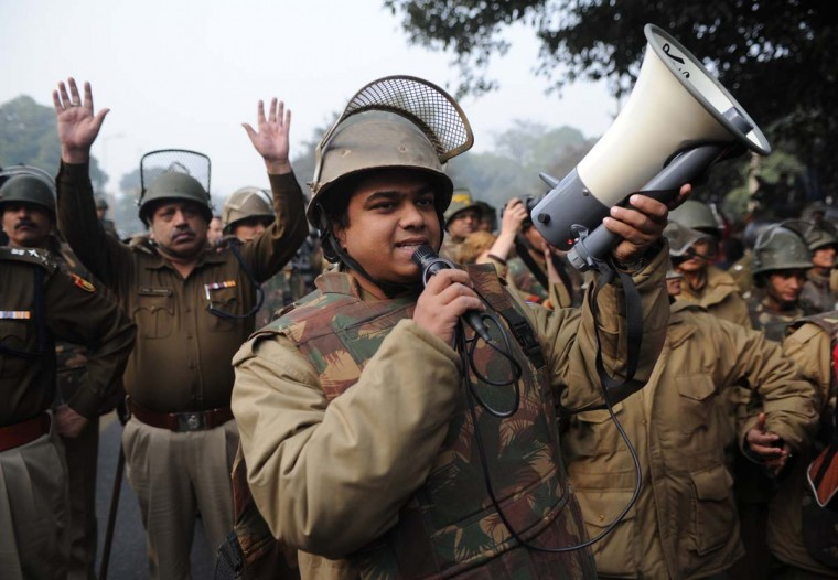 An Indian policeman uses a megaphone to direct demonstrators as they move towards India Gate in New Delhi on December 27, 2012, during a protest calling for better safety for women following the rape of a student in the Indian capital. Protests across India over the last week against sex crimes have denounced the police and government, with the largest in New Delhi at the weekend prompting officers to cordon off areas around government buildings. One policeman was killed and more than 100 people injured in the violence. (Sajjad Hussain/APF/Getty Images)