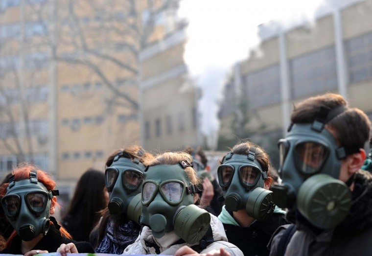 A group of young ecologists march with gas masks during a protest to draw attention to atmospheric pollution in Skopje on December 27, 2012.Skopje is one of the most polluted towns in Europe,concentration of dust is 16 times greater than allowed. (Robert Atanasovski/AFP/Getty Images)