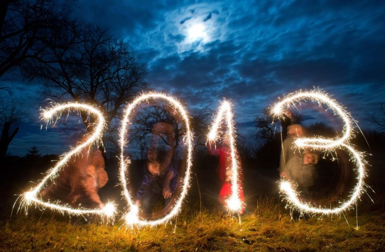 "Posed picture taken with long exposure time on December 26, 2012 shows four persons writing the year ""2013"" with sparklers in the evening sky near Sieversdorf, eastern Germany. (Patrick Pleul/AFP/Getty Images)"