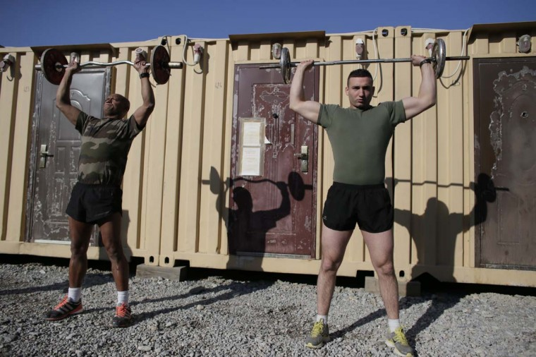 French soldiers work out at Warehouse base in Kabul on December 31, 2012. All French combat troops have now been withdrawn from Afghanistan and only training and logistics personnel remain there. (Kenzo Tribouillard/AFP/Getty Images)