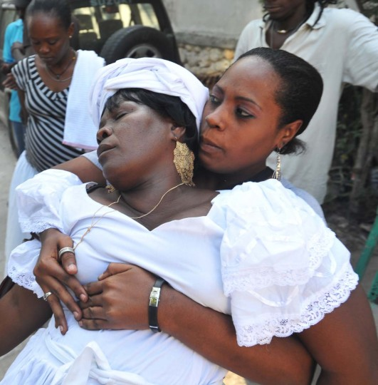 Women take part in a Voodoo ceremony December 30, 2012 in the Petion-ville suburb of Port-au-Prince. The Haitian government declared Voodoo an official religion in 2003, granting Voodoo priests the authority to perform weddings and baptisms. (Thony Belizaire/AFP/Getty Images)