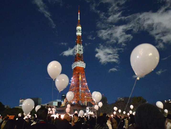 People gather to release balloons to celebrate the New Year's during an annual countdown ceremony produced by the Prince Park Tower Tokyo, flagship of the Prince hotel chain in Tokyo on December 31, 2013. Some 1,000 balloons were released in the air with the visitors wishes. (Kazuhiro Nogi/AFP/Getty Images)