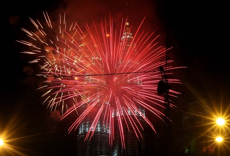 Fireworks burst in the sky near Malaysia's landmark Petronas Twin Towers during the New Year celebrations in Kuala Lumpur on January 1, 2013. (Mohd Rasfan/AFP/Getty Images)