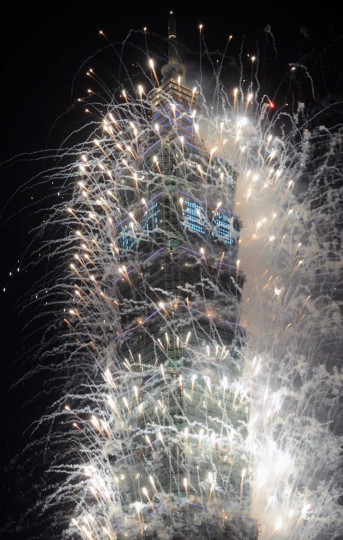 Fireworks are launched from the Taipei 101 building to mark the new year in Taipei on January 1, 2013. In line with the countdown will be a 188-second firework show to be presented by the Taipei 101, a 509-metre-high skyscraper and once the world's tallest building which is just hundreds of metres away from the city hall square. (Sam Yeh/AFP/Getty Images)