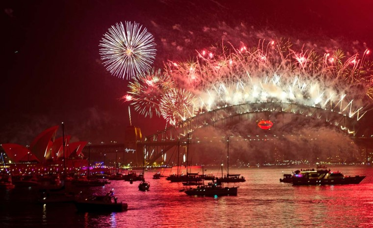 Spectator boats in Sydney Harbour look on as New Year's Eve fireworks erupt over the Sydney Harbour Bridge on January 1, 2013. Sydney kicked off a wave of dazzling firework displays welcoming in 2013, from Dubai to Moscow and London, with long-isolated Yangon joining the global pyrotechnics for the first time. (Manan Vatsyayana/AFP/Getty Images)