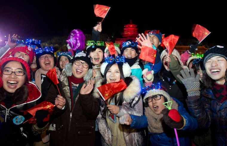 Revellers celebrate the new year during a count-down event at the Summer Palace in Beijing on January 1, 2013. (Ed Jones/AFP/Getty Images)
