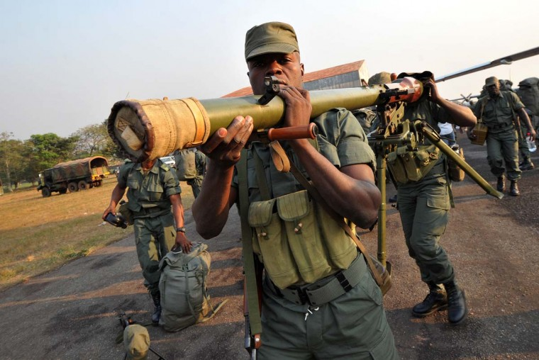Soldiers from Congo Brazzaville, part of the Multinaional Force of the Economic Community of Central African States (FOMAC), unload military equipment as they arrive at the airport in Bangui, on December 31, 2012. Congo announced today the deployment of a battalion of 120 soldiers to the Central African Republic's capital Bangui at the request of the Tchadian President Idriss Deby, who is currently the president of FOMAC. Meanwhile rebels in the Central African Republic vowed to take the last key town before the capital and renewed their call for the president to stand down, voicing scepticism over his pledge to make concessions. (Sia Kambousia/AFP/Getty Images)