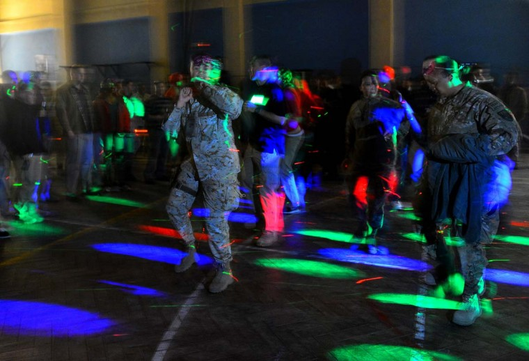NATO troops from the International Security Assistance Force (ISAF) dance during celebrations on New Year's Eve right before the start of 2013 in Kabul on December 31, 2012. Thousands of NATO troops across Afghanistan celebrated the new year away from their homes. (Massoud Hossaini/AFP/Getty Images)
